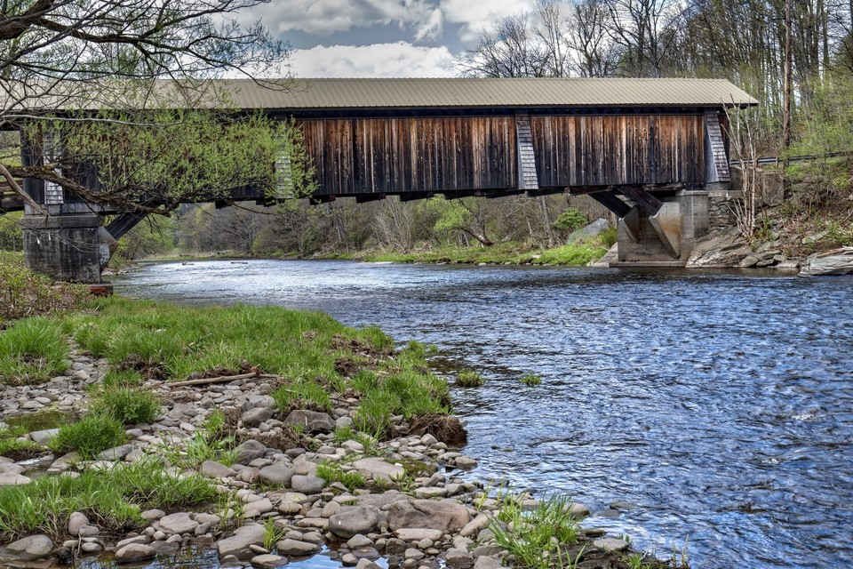 covered bridge over river in the Catskills