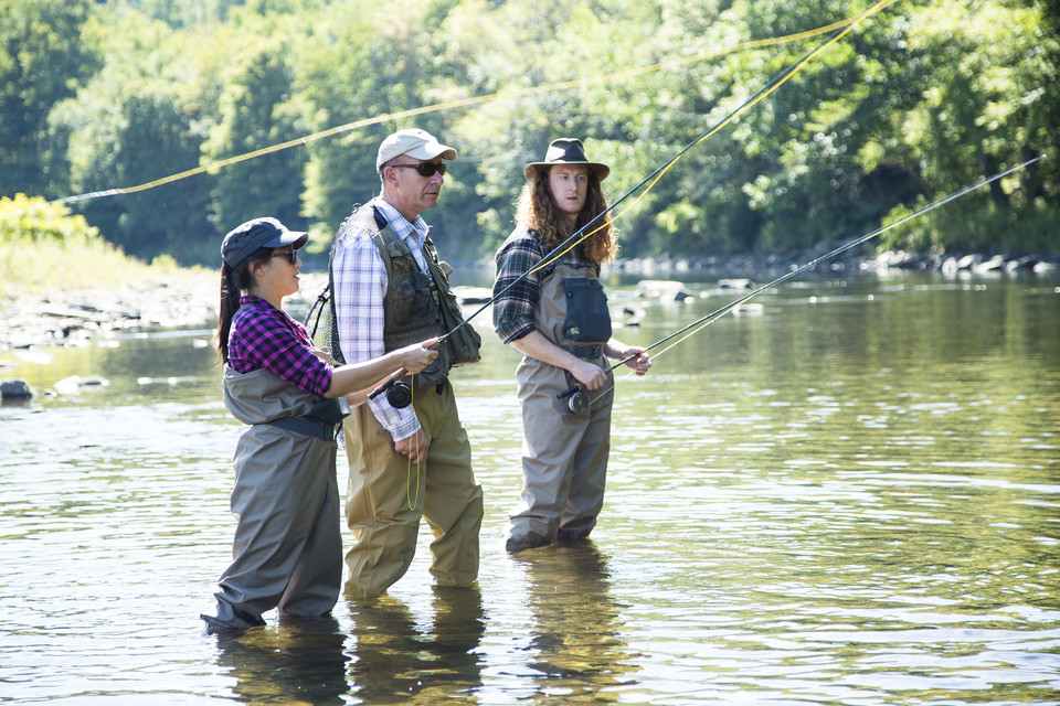 three people learning to fly fish in the Catskills