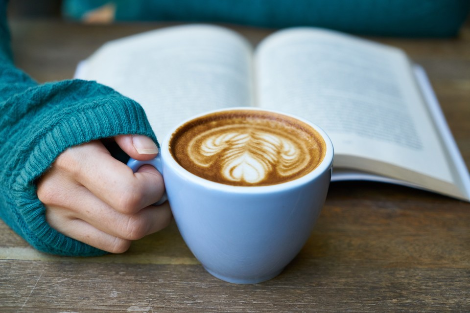 latte next to a book