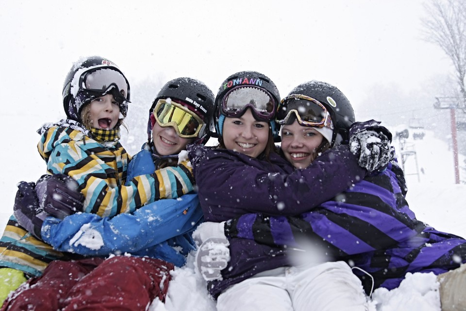 group of friends enjoying winter fun in the Catskills
