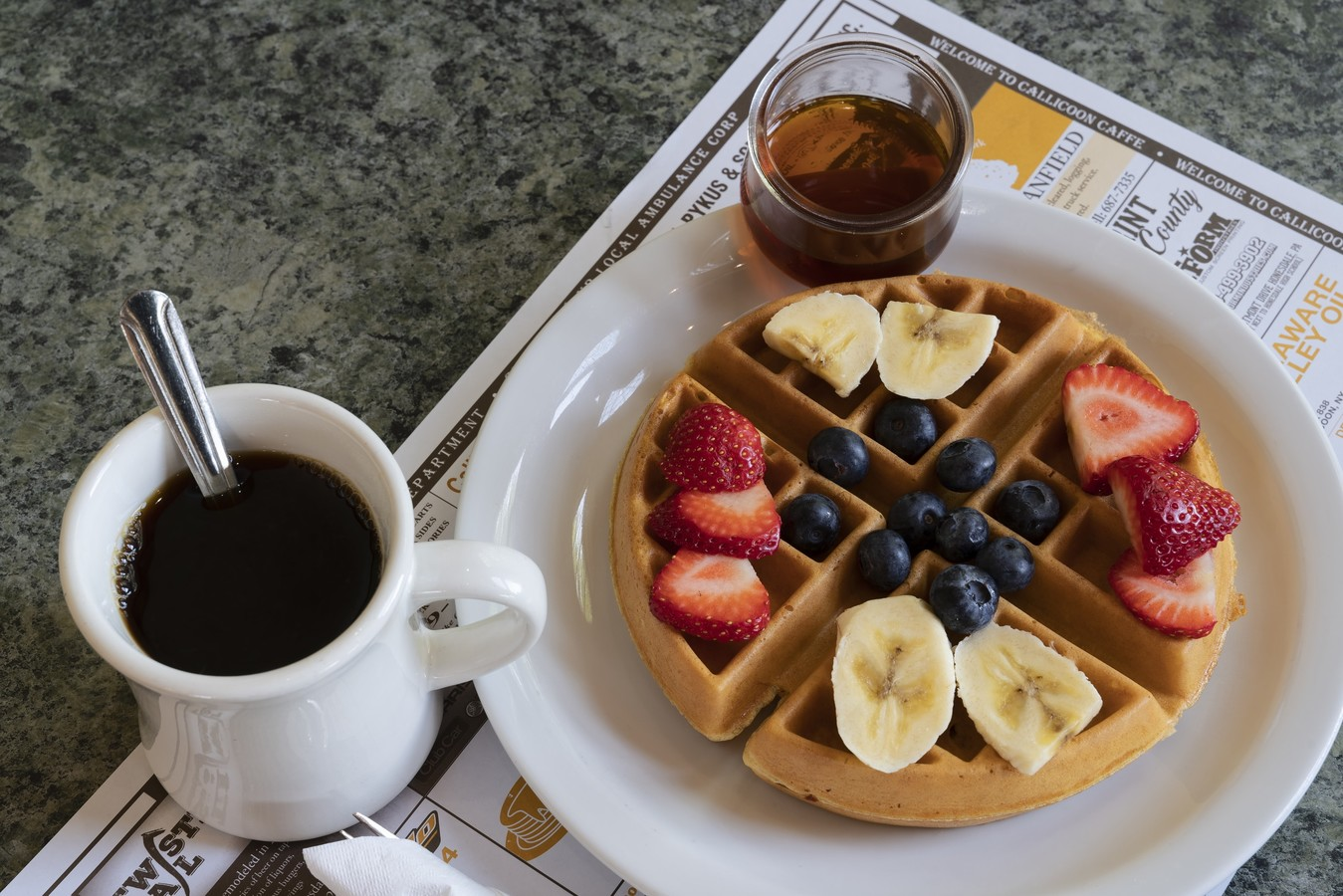 coffee paired with a waffle & fruit breakfast