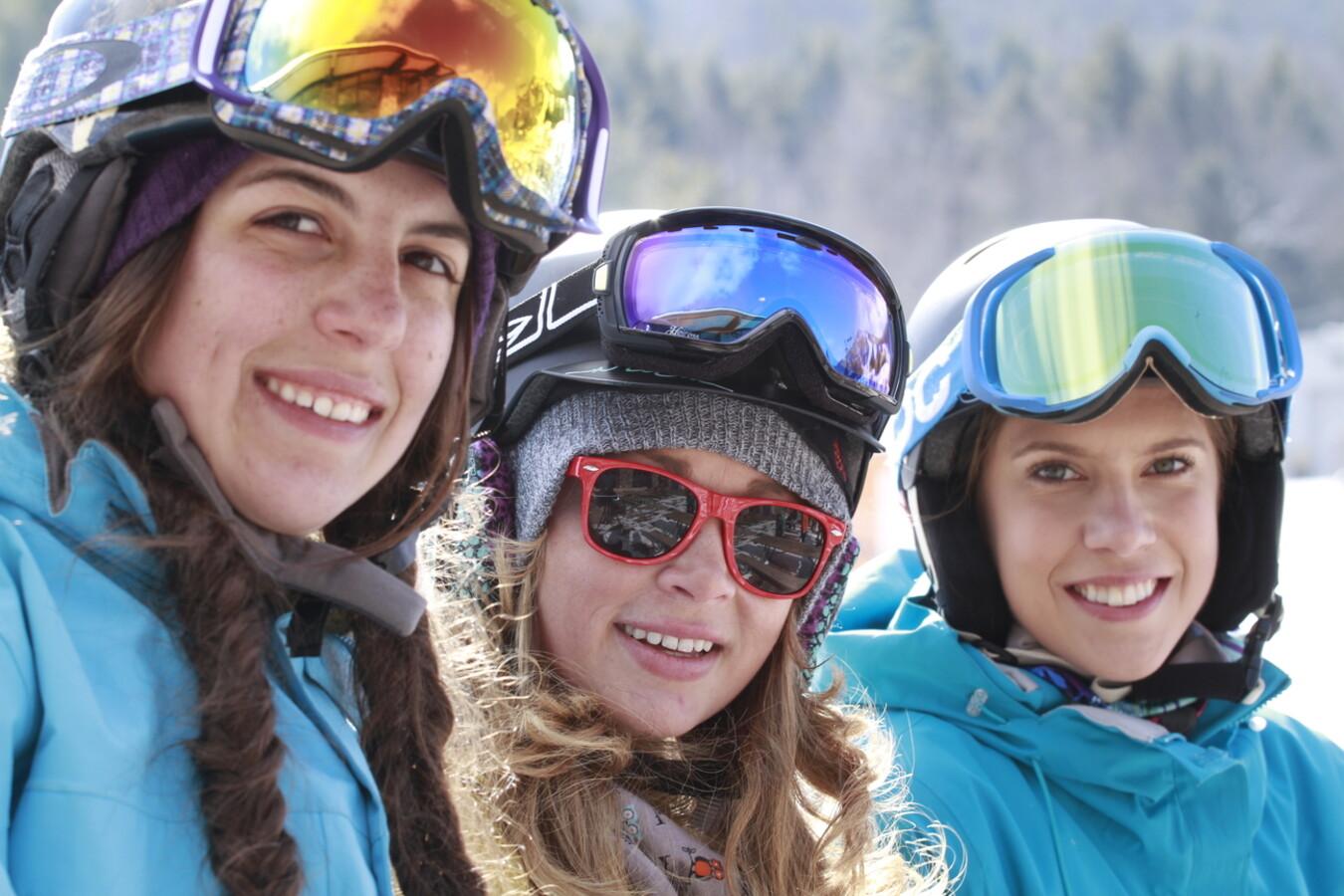friends snowboarding in the Catskills