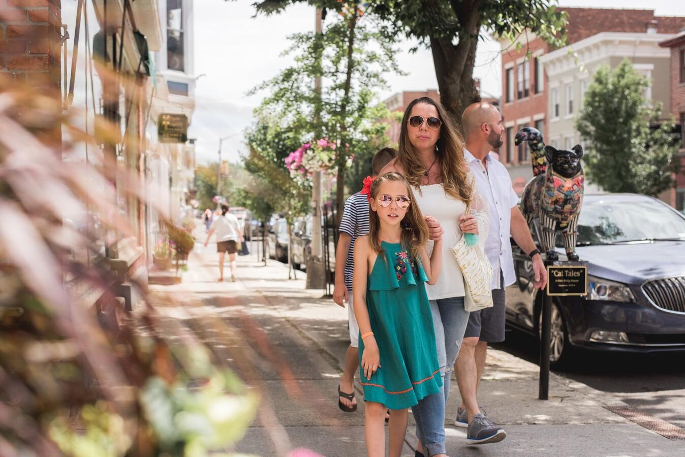family walking around Catskills small town
