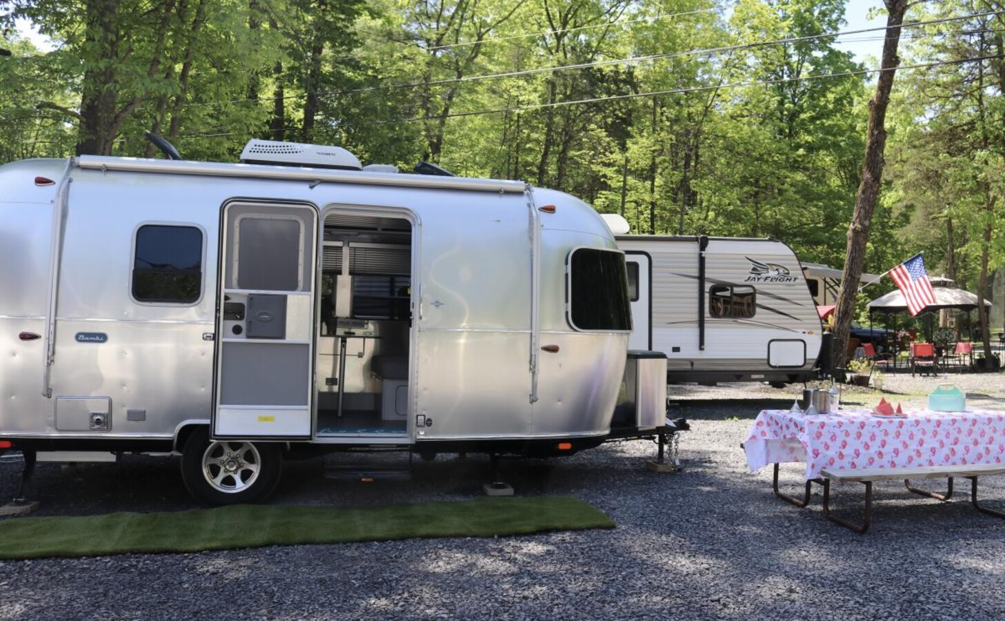 Airstream and camper parked at campgrounds