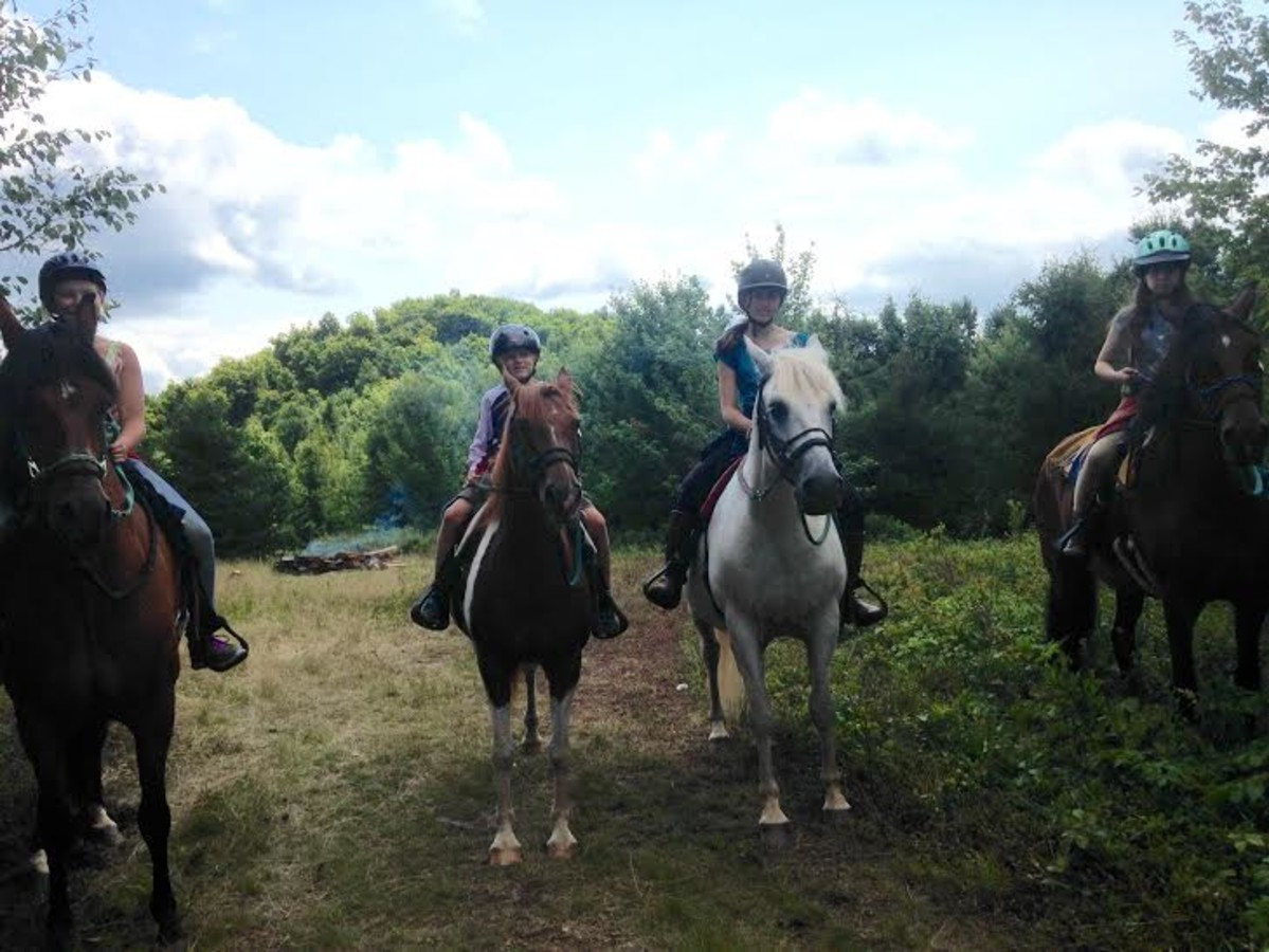 group of people horseback riding in the Catskills