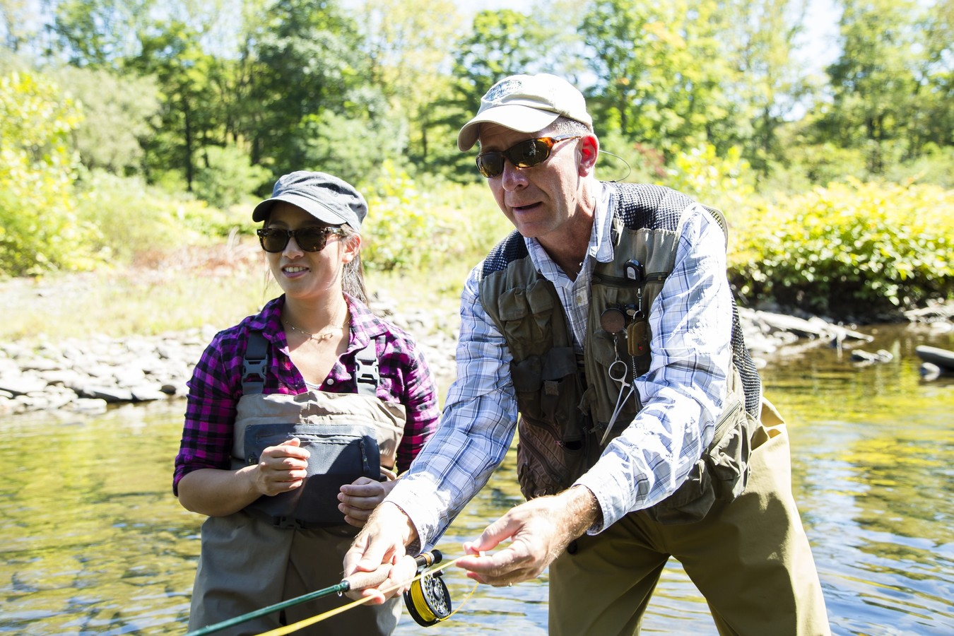 Catskills fly fishing guide teaching woman