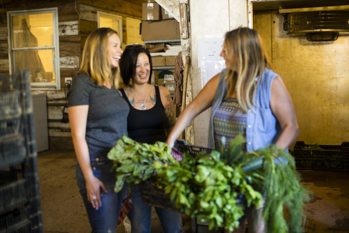 two women at farm learning about farm-to-table